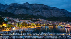 Time lapse of Makarska harbour and its old town from above. Stock Footage