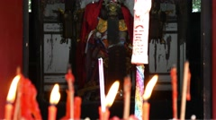 China Taoist temple burning candles with God Stock Footage