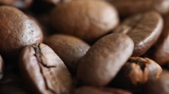 Rotating roasted coffee beans background concept interesting Stock Footage