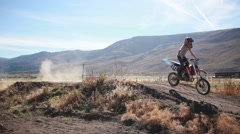 Motocross rider jumps dirt track HD  Stock Footage