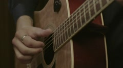 Closeup of male hands playing acoustic guitar Stock Footage