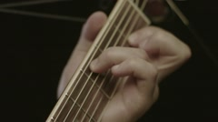 Closeup of man's hands playing acoustic guitar Stock Footage