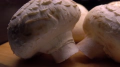 Fresh raw champignons 4K close up pan shot Stock Footage