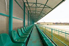 Rows of seats in an empty stadium. Green seats at the stadium Stock Photos