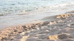 Female feet legs walking on the sand beach Stock Footage