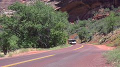 Zion tourist bus passing Stock Footage