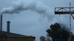 Smoke From The Boiler House Chimney Pipe Against Blue Sky In Distance HD Stock Footage