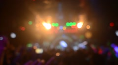 Silhouettes of concert crowd in front of bright stage lights Stock Footage