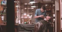 Hairdressing at barbershop 4k video. Barber cutting beard clipper lumberjack Stock Footage