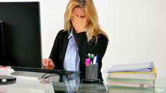 Tired woman working at computer Stock Footage