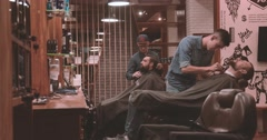 Hairdressing barbershop top view 4k video. Barbers cutting beard with clipper Stock Footage