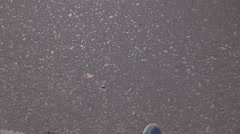 First-person view, walking in a countryside road full of tiny pebbles. Stock Footage