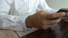 Man paying online inserting credit card number on mobile phone. Internet banking Stock Footage