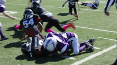 The ball carrier is hit hard & fumbles ball at the youth football game, 3708 Stock Footage