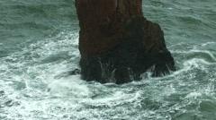 Ocean wave hitting rocks Foams spraying and splashing Stock Footage