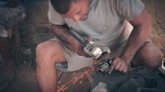 Mechanic in third world fixing engine part Stock Footage
