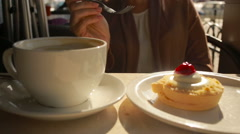 Woman eating cake at outdoors cafe. cheese cake closeup Stock Footage