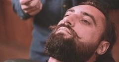 Barber grooming mustache with wax beard barbershop 4k close-up lumberjack video Stock Footage
