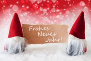 Red Christmassy Gnomes With Card, Neues Jahr Means New Year Stock Photos