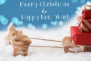 Reindeer, Sled, Light Blue Background, Text Merry Christmas, New Year Stock Photos
