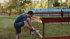 Young athletic man doing warm-up before exercise and jogging Stock Footage