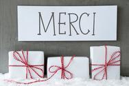 White Gift On Snow, Merci Means Thank You Stock Photos