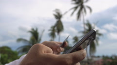 Man paying online with palm trees on backround. Internet banking Stock Footage
