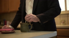 Businessman at home drinking coffee realizes he is late for work 4k Stock Footage