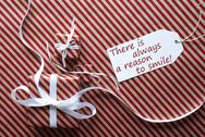 Two Gifts With Label, Quote Always Reason To Smile Stock Photos