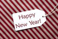 Label On Red Wrapping Paper, Text Happy New Year Stock Photos