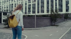 Young woman Using Gyroscooter. Fashion clothes. Bright backpack behind Stock Footage