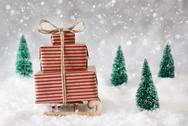 Christmas Sled On Snow With White Background, Snowflakes And Stars Stock Photos