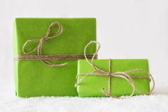 Two Green Gifts Or Presents On Snow, White Background Stock Photos