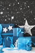 Vertical Blue Christmas Gifts, Black Cement Wall, Snow, Snowflakes Stock Photos