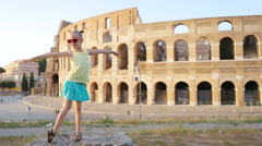 Little girl having fun in front of Colosseum in Rome, Italy. Kid spending Stock Footage