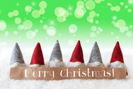 Gnomes, Green Background, Bokeh, Stars, Text Merry Christmas Stock Photos