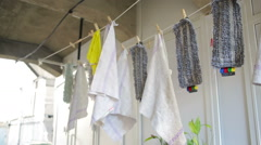 Doormats are dried on the clothesline. towels on clothesline. cloth in the wind Stock Footage