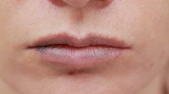 Female lips with bruise. close-up. effects of hyaluronic acid. lip augmentation Stock Footage