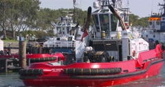 Tug Smit Hudson sets sail from homebase ROTTERDAM Seaport Stock Footage