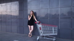 Young Pretty Lady Portrait Looking Camera With Shopping Cart in Mall Stock Footage