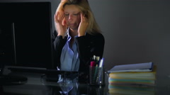 Woman using computer at night eyes pain Stock Footage