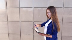 Female Business Student Write Down Notes Stock Footage