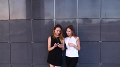 Two Student Female Friends Laught Look at Phone Stock Footage