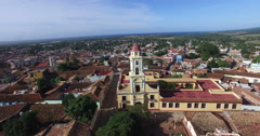 Bird's-eye panoramic view around main yellow chapel, roofs of ancient houses, Stock Footage