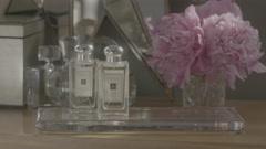 Dollying hero shot of fancy perfume bottles. Stock Footage