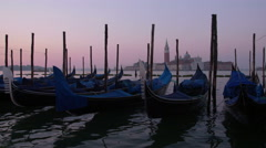 Gondolas view on San Giorgio Maggiore at sunrise, in Venice, Italy Stock Footage