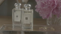 Dollying hero shot of fancy perfume bottles. Stock Footage