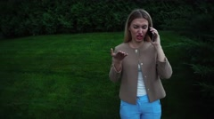 Young Beautiful Blond Female Talking on Phone Angry, Indignant, Expressed Claim Stock Footage
