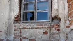 Old Dirty Broken Glass Window on Old Dirty Wall / Window / Damaged Building Stock Footage
