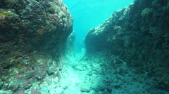 Moving in a trench underwater on the ocean floor Stock Footage